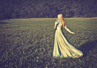 beautiful girl in long green dress in summer onnature