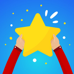 Two male hands holding a large yellow star on a blue sky backgro