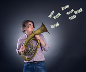 A man plays the trumpet blowing out her money.