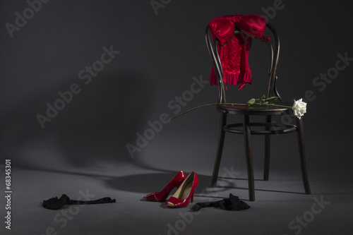 Sexy lingerie, shoes and a white rose on a retro chair. - 68345301