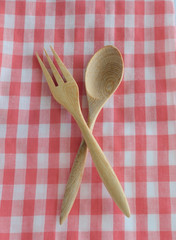 wooden spoon on checkered tablecloth