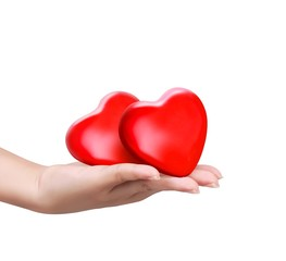 Red heart at the woman hand