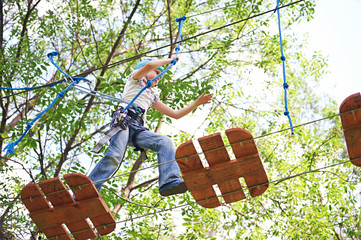 Girl is climbing to high rope structures
