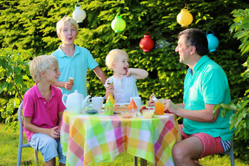 Happy family having lunch outdoors