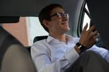 Fototapety Businessman phone back seat car