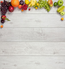 different fruits and vegetables on wooden table