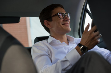 Businessman phone back seat car