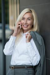 Businesswoman talking cellphone outdoor