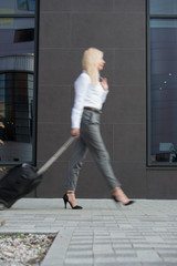 Business woman walking suitcase office building hotel