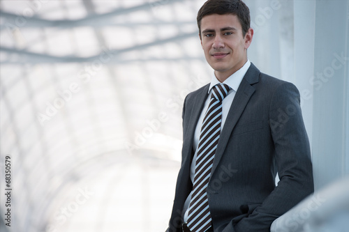 canvas print picture Businessman standing relaxed