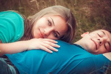 Romantic couple relaxing in field