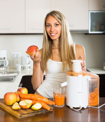 Woman preparing juice in kitchen