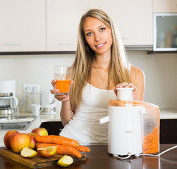 Woman preparing juice in kitchen