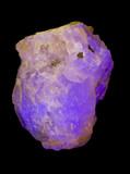 Fluorescent Fluorite under ultraviolet light. 10cm high. poster