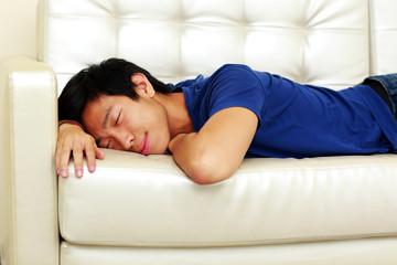 Portrait of asian man sleeping on the sofa