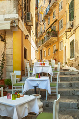 Small restaurant standing on typical narrow street