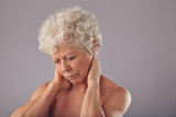 Senior woman in discomfort with sore neck poster