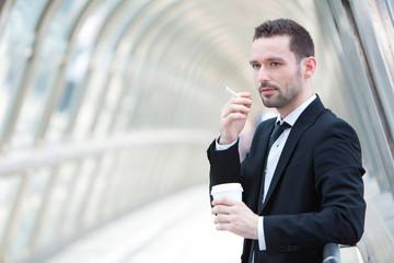 Portrait of an attractive businessman having a break