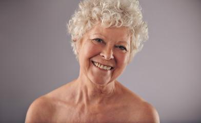 Happy mature female smiling at camera