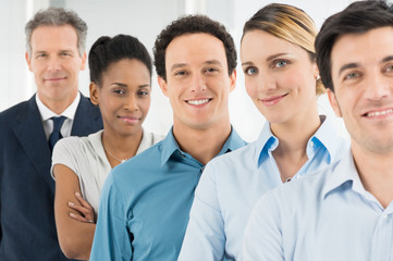 Satisfied Businesspeople Standing In A Row