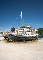 rotting boats in greek boatyard
