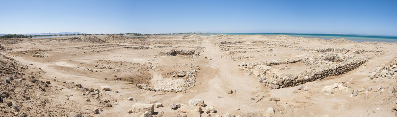 Old roman ruins on desert coastline