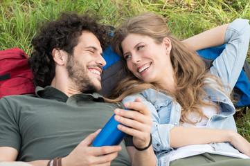 Young Couple Lying On Meadow