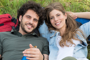 Smiling Couple Lying On Grass