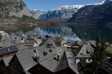 Village with lake and Alps range background