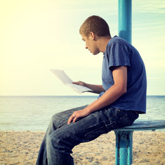 Teenager read Letter outdoor