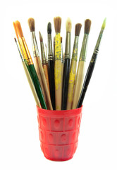 Paint brushes set in the red cup