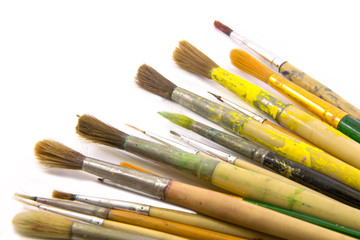 Paint brushes on white bcakground