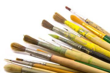 Paint brushes on white bcakground