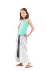 Smiling girl in gray long skirt