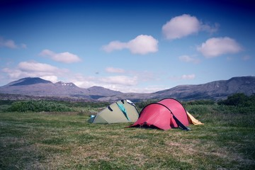 Camping tents in Iceland. Cross processed color tone.