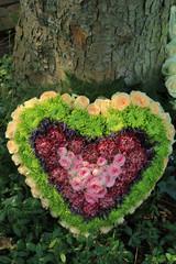 Heart shaped sympathy flower arrangement
