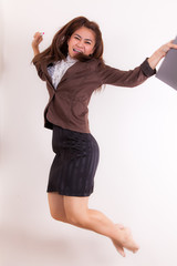 Cute business woman jumping