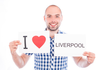 Man with city sign Liverpool.