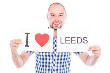Man with city sign Leeds.