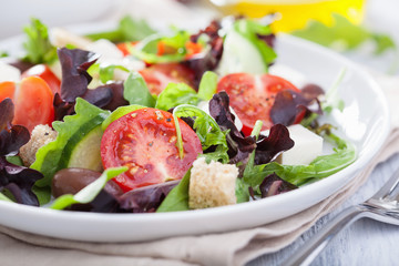 healthy salad with tomatoes olives and feta cheese