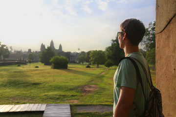 Tourist looking at Angkor Wat temple in Cambodia