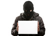 Criminal man in balaclava or mask covering face holding blank wh