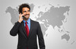 Man talking on the phone in front of a world map