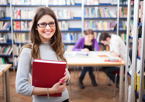 canvas print picture Portrait of a student in a library