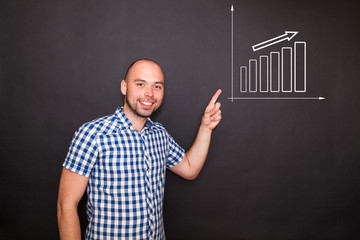 Man pointing  his finger to the graph