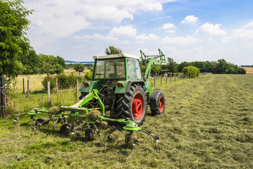 Tractor on mown field