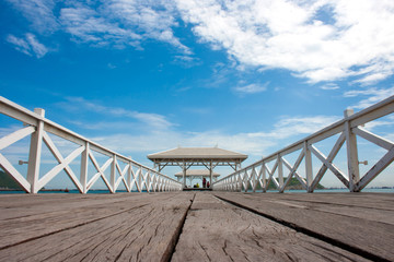 white wooden bridge in waterfront pavilion at the sea