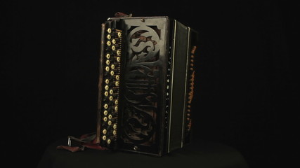 Accordion rotates on a black background loop