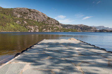 View over a dock at Revsvatnet lake, Norway