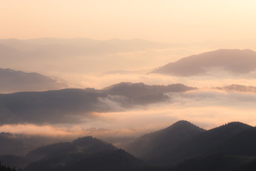 Mountains hills at foggy morning
